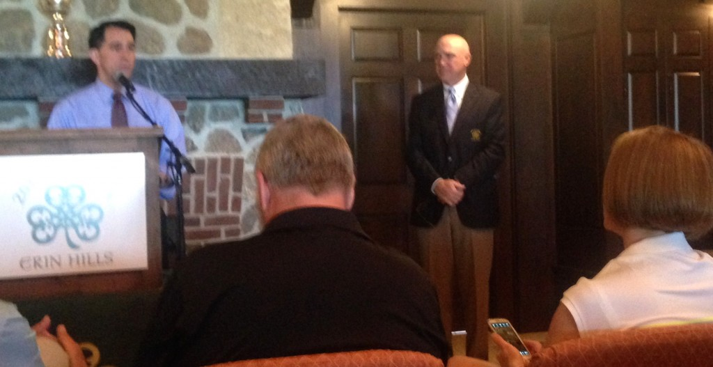 Governor Scott Walker, with Reinhart looking on, stresses the value of golf to Wisconsin residents.