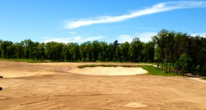 One of the anticipated 41 sand bunkers is already in place at Tom Doak's next course.