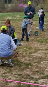 Instructors helped each youngster when they made their first swings on the practice range.