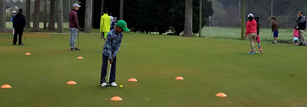 Putting wasn't part of the first session at First Tee but there was still time to use the practice green.